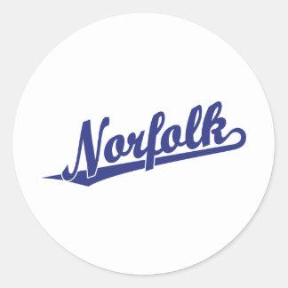 Norfolk script logo in blue round sticker