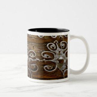 Norman iron scroll work on wooden door Two-Tone coffee mug