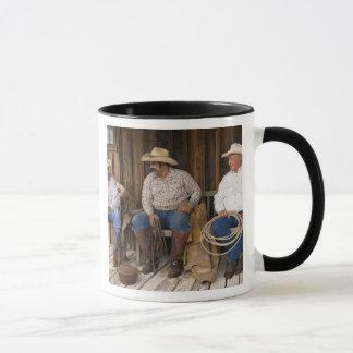 North America, USA. Cowboys relaxing and Mug