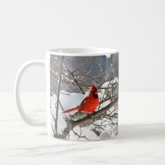 Northern cardinal in the snow coffee mug