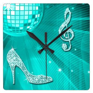 Note turquoise scintillante de musique et talon horloge carrée