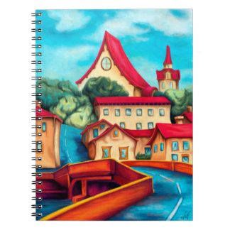 Notebook painting village houses with the red