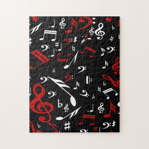 Notes musicales rouges et blanches sur le noir puzzle