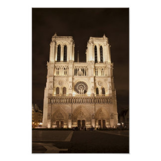 Notre Dame cathedral at night Poster