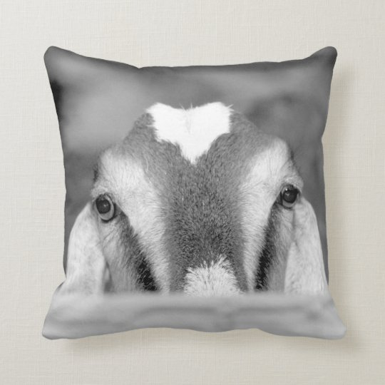 Nubian doe bw peeking over wooden rail.jpg throw pillow