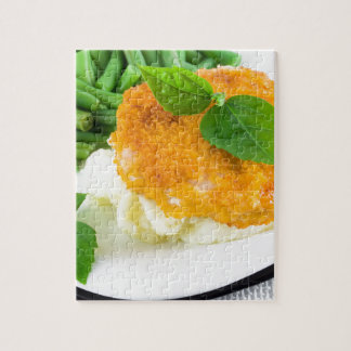 Nuggets of chicken, mashed potatoes and green bean jigsaw puzzle
