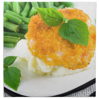 Nuggets of chicken, mashed potatoes and green bean napkin