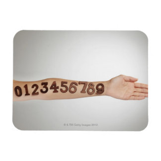 numbers affixed to the arm,ands close-up rectangular photo magnet