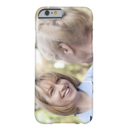 Nurse smiling and talking to a senior woman iPhone 6 case