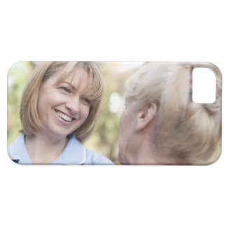 Nurse smiling and talking to a senior woman iPhone 5 cover