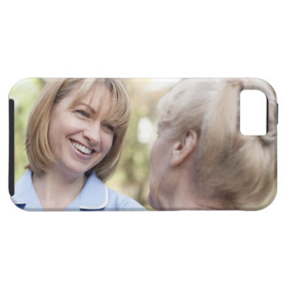 Nurse smiling and talking to a senior woman iPhone 5 cases