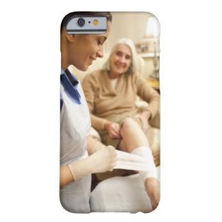 Nurse wrapping bandage on senior woman's leg to barely there iPhone 6 case