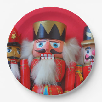 Nutcrackers in red uniforms paper plate