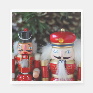 Nutcrackers with holiday background paper napkins