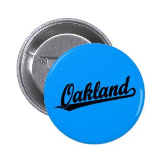 Oakland script logo in black pins