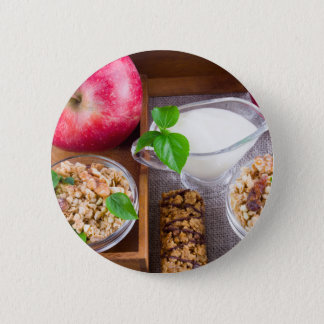 Oat cereal with nuts and raisins 2 inch round button