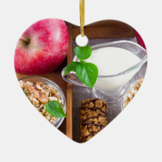 Oat cereal with nuts and raisins ceramic heart ornament