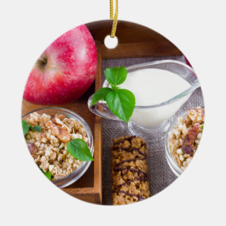 Oat cereal with nuts and raisins round ceramic ornament