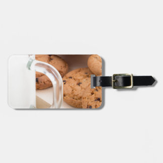 Oatmeal cookies and milk for breakfast close-up luggage tag