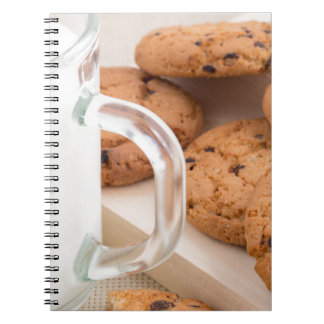 Oatmeal cookies and milk for breakfast close-up notebooks