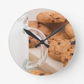 Oatmeal cookies and milk for breakfast close-up wall clocks