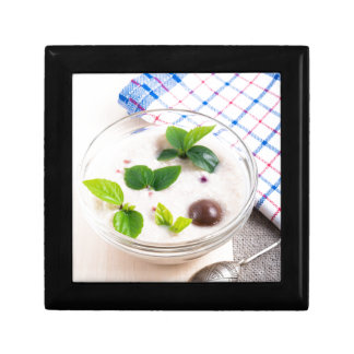 Oatmeal in a bowl of glass with chocolate candy gift box