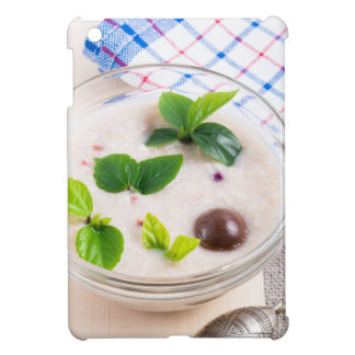 Oatmeal in a bowl of glass with chocolate candy iPad mini cases