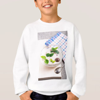 Oatmeal in a bowl of glass with chocolate candy sweatshirt