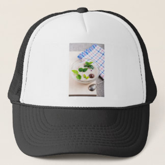 Oatmeal in a bowl of glass with chocolate candy trucker hat