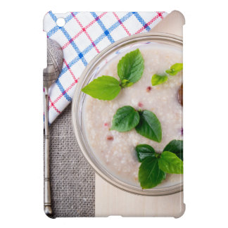 Oatmeal with chocolate candy and a silver spoon iPad mini case