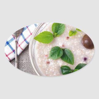 Oatmeal with chocolate candy and a silver spoon oval sticker