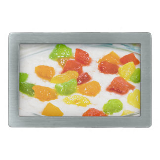 Oatmeal with colorful candied fruits in a glass rectangular belt buckles