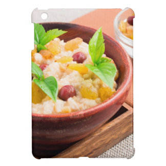 Oatmeal with raisins and berries in a wooden bowl iPad mini cases