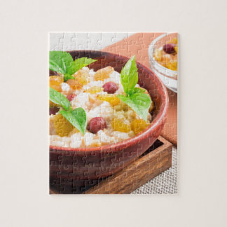 Oatmeal with raisins and berries in a wooden bowl jigsaw puzzle