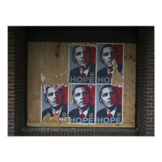 Obama signs in a boarded window of a closed print