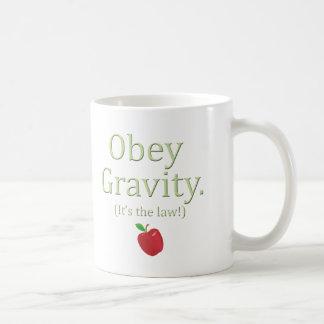 obey gravity- it's the law! coffee mug