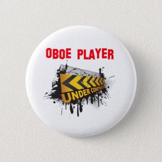 Oboe player under construction 2 inch round button