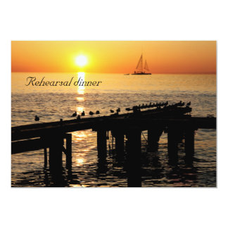 ocean at sunset with seagulls rehearsal dinner card