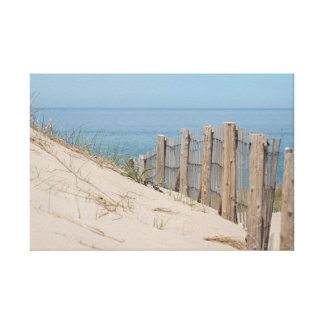 Ocean view and dune fence on Cape Cod Canvas Print
