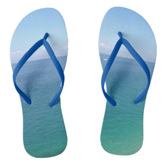 Oceans adult flip flops with blue straps.