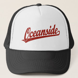 Oceanside script logo in red distressed trucker hat