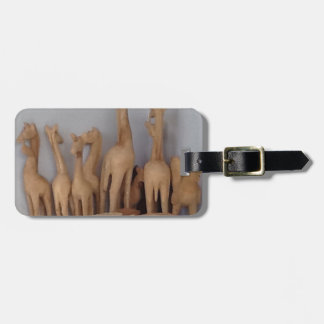 Ocho carvings luggage tag