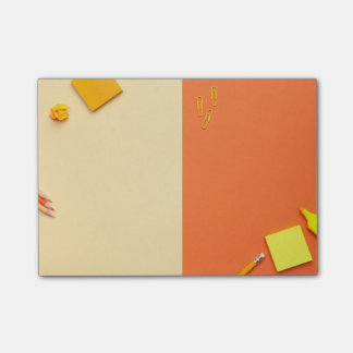 Office Accessories on Yellow and Orange Background Post-it Notes