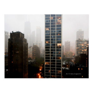 Office towers, condos and Hancock Tower in fog Postcard