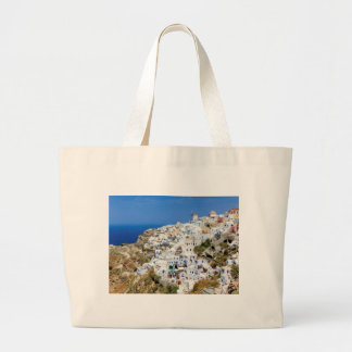 Oia village on Santorini island, north, Greece Large Tote Bag