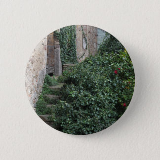 Old abandoned country homestead in the woods 2 inch round button