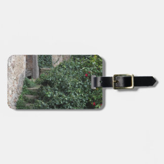 Old abandoned country homestead in the woods luggage tag