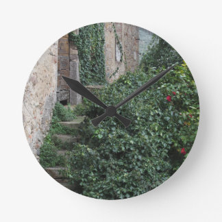 Old abandoned country homestead in the woods round clock