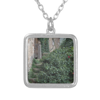 Old abandoned country homestead in the woods silver plated necklace