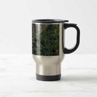 Old abandoned country homestead in the woods travel mug